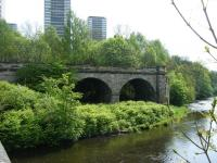 Part of the former Glasgow Central Railway viaduct over the River Kelvin, seen looking east from Kelvindale Road in May 2011. To the left was Dawsholm, which lost its passenger service as long ago as 1908 but remained open to goods traffic for a further 60 years. The former GCR route to Bellshaugh Junction headed off to the right.<br><br>[Veronica Clibbery&nbsp;07/05/2011]
