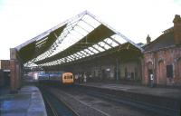 The 1879 NER station at South Shields  seen in 1974 with a DMU from Newcastle Central standing at the platform. The old station is long gone, with Tyne & Wear Metro services now using a modern replacement opened in 1984 a short distance to the west. [See image 6172]<br><br>[Ian Dinmore&nbsp;//1974]