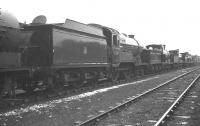 Robinson D11 4-4-0 no 62691 <I>Laird of Balmawhapple</I> stands in the sidings alongside Boness Harbour in February 1962 in company with various other steam locomotives stored there awaiting disposal. Built by Armstrong - Whitworth in 1924, no 62691 had been withdrawn from Haymarket shed 3 some months earlier. It was eventually cut up at Connels of Calder the following March. <br><br>[K A Gray&nbsp;26/02/1962]