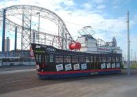 'L' Plates displayed but is that for a tram driving licence or a skipper's ticket? <I>Trawler Tram</I> 737, promoting Fleetwood based 'Fisherman's Friend' lozenges, is on training duties at the Pleasure Beach turning circle but being driven from the <I>stern end</I>. After several years out of service the tram was restored for the 2016 illuminations.<br><br>[Mark Bartlett&nbsp;11/05/2011]