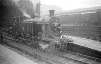 St Margarets C16 4-4-2T no 67492 at Princes Street on 6 September 1958 in connection with the SLS (Edinburgh Section) <i>Lothian Lines Tour</i>. The 4-coach special covered various branches in Edinburgh and the Lothians, starting and finishing at Princes Street station. Lothian Road goods depot stands in the background.<br><br>[Robin Barbour Collection (Courtesy Bruce McCartney)&nbsp;06/09/1958]
