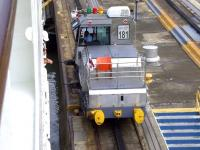 <I>Mule</I> locomotive no 181 assists the P&O liner 'Oceana' on its journey through the Panama Canal in November 2010. These rack mounted electric locomotives, fitted with powerful winches, are used for side-to-side and braking control on many of the larger vessels using the canal locks. Some of the biggest ships negotiating the locks (often leaving only a 2 ft clearance on each side) can require the combined assistance of 8 such <I>mules</I>. [See image 34074]<br><br>[Brian Smith&nbsp;15/11/2010]