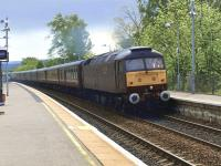 Train 1Z46 rushes through Bridge of Allan on 13 May 2011. The Compass Tours <I>'North Wales Scotsman'</I> was en route from Holyhead to Dundee behind WCRC 47804.<br><br>[Brian Forbes&nbsp;13/05/2011]