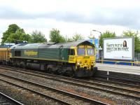 <I>There's no answer to that...</I> Freightliner 66607 looks puzzled as it pulls up with a northbound ballast train at Oxford on 17 May for a crew change.<br><br>[Peter Todd&nbsp;17/05/2011]