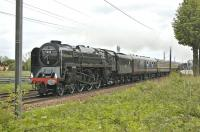 <I>'The Lothian Tornado'</I>, on its way from Sheffield to Edinburgh, charges over St Germains level crossing on 17 May 2011 behind 71000 <I>'Duke of Gloucester'</I> which had taken over the train at York.<br><br>[Bill Roberton&nbsp;17/05/2011]