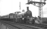 Highland Railway <I>Jones Goods</I> 4-6-0 no 103 together with the preserved Caledonian coaches standing at signals at Aviemore station on 30 August 1965. The locomotive and coaches were returning south with the 1.35pm Inverness - Perth special working [see image 31765].<br><br>[K A Gray&nbsp;30/08/1965]