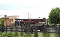 Restored GWR steam railmotor no 93 in operation at the Great Western Society depot at Didcot on 17 May 2011. Photographed from the platform at Didcot Station.<br> <br><br>[Peter Todd 17/05/2011]