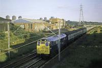 A special seaside excursion to Clacton is seen approaching Hythe station in Colchester on its evening return journey behind 31 145. Whether it was an �Adex� or �Mystex� is not known, but those on board had been very lucky with the weather that day, 1st September 1977.<br><br>[Mark Dufton&nbsp;01/09/1977]