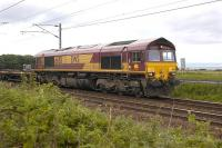 DBS 66151 passes St Germains on 17 May with empty pipe wagons from Leith South yard.<br><br>[Bill Roberton&nbsp;17/05/2011]