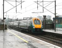 With heavy rain falling over North London on 23 July 2005, a Hull Trains service accelerates through Finsbury Park on the down ECML shortly after leaving Kings Cross. Meantime, in the left background, construction work continues on Arsenal FC's new Emirates Stadium. <br><br>[John Furnevel&nbsp;23/07/2005]