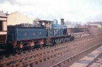 Scene at Lanark station on 26 April 1958 with ex-CR 4-2-2 no 123 about to leave with the <I>'Caledonian 123 Excursion'</I> to Muirkirk. [See image 32807]<br><br>[A Snapper (Courtesy Bruce McCartney)&nbsp;26/04/1958]