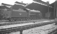 Maunsell 'Schools' class 4-4-0 no 30902 <I>Wellington</I> stands in the shed yard at 70A Nine Elms in August 1961.<br><br>[K A Gray&nbsp;21/08/1961]