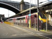 Voyager unit 220023 sits under North Bridge after arrival on platform 8 at Waverley coupled to sister unit 220029 on the 07.03 ex Birmingham New Street Cross Country east coast route service. <br><br>[David Pesterfield&nbsp;10/05/2011]
