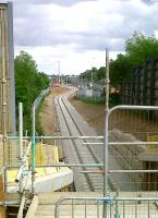 Progress at DIRFT looking south east towards the main depot and yard on 20 May [see image 33772] with rails now passing under the A5. The class 66 lurking in the undergrowth on the right is no 708.<br><br>[Ken Strachan&nbsp;20/05/2011]