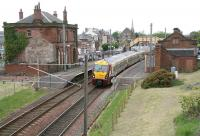 The 12.16 Largs - Glasgow Central restarts after calling at Saltcoats  on 17 May 2007. The station, the third to serve Saltcoats, was opened in 1882, although the town's New Trinity Church in the background pre-dates it by more than a century.<br> <br><br>[John Furnevel&nbsp;17/05/2007]