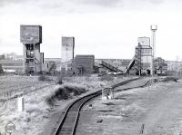 Monktonhall Colliery, located on the west side of Millerhill Yard, seen from the south in 1987. Closed in 1997 and since demolished, it will be the location of Shawfair Station on the reopened Waverley Route.<br> <br><br>[Bill Roberton&nbsp;//1987]