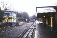A wet platform in Metroland. View south east towards London from the buffer stops at the colourful Metropolitan Line terminus at Chesham in October 1988.<br><br>[Ian Dinmore&nbsp;/10/1988]