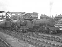 An up ECML express rushes south through Doncaster station on 29 July 1961 hauled by A2 Pacific no 60524 <I>Herringbone</I>. Standing at the platform is K3 2-6-0 no 61965 which has recently arrived with the 2.40pm from Hull.<br><br>[K A Gray&nbsp;29/07/1961]