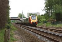A lengthy southbound Voyager, diverted via the Settle & Carlisle line, photographed on 21 May 2011 shortly after passing below the M6 motorway at Bamber Bridge.<br><br>[John McIntyre&nbsp;21/05/2011]
