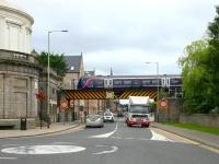 Having just crossed the River Tay, an afternoon Aberdeen - Glasgow Queen Street service now crosses a Street with the same name in July 2006. The train is about to pass through the remains of the former Perth Princes Street station [see image 9931] which stands behind the Fergusson Gallery on the left.<br><br>[John Furnevel&nbsp;15/07/2006]