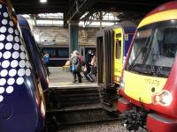 Odd one out times two. 170434 for Dundee in Saltire livery and 170458 for Glasgow Queen Street become blocked in at Waverley west end shortly after mid-day on 10 May by new arrivals 156442 also in Saltire livery plus SPT liveried 170475.<br><br>[David Pesterfield&nbsp;10/05/2011]