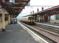 An Airdrie - Helensburgh service arrives at Dumbarton Central station on a fine July morning in 2005.<br><br>[John Furnevel&nbsp;10/07/2005]