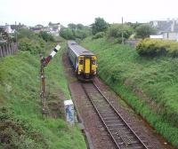 The first down train of the day is almost on the sea wall as it drops down the link line from Stranraer Town station to the Harbour on 25 May 2011. 156506 will, after a 40 minute layover in the quayside station, head back north on the 2 1/2 hour run to Glasgow. <br><br>[Mark Bartlett&nbsp;25/05/2011]
