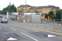 The single-platform terminus at East Kilbride looking west along Torrance Road on a Monday morning in August 2006. The buffer stops are just off picture to the right, while to the left is the large station car park. The 10.26 service, calling all stations to Glasgow Central, is currently boarding. <br><br>[John Furnevel&nbsp;21/08/2006]