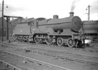 Fowler ex-LMS 2P 4-4-0 no 40695 stands on Kingmoor shed in April 1960.<br><br>[Robin Barbour Collection (Courtesy Bruce McCartney)&nbsp;14/04/1960]