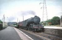 Gresley V2 2-6-2 no 60951 takes an ECML train south through Joppa on 8 August 1959, passing a North Berwick - Corstorphine DMU standing at the down platform.<br><br>[A Snapper (Courtesy Bruce McCartney)&nbsp;08/08/1959]