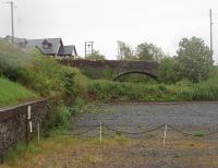 Most of the Glenluce station site has been built over since the 1965 closure of the <I>Port Road</I>. However, at the east end is a small car park overlooked by this road overbridge and with the low retaining wall still intact. View towards Newton Stewart.<br><br>[Mark Bartlett&nbsp;23/05/2011]