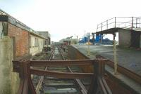 Looking from the end of the headshunt from Stranraer Harbour platform 2 in March 2006 towards the Station. A run-round loop was still in situ there but the loop for platform 1 had been disconnected. The only pedestrian access to platform 2 at this stage was by picking a way round the end of the tracks, the footbridge having been removed. [See image 27142] <br> <br><br>[Colin Miller&nbsp;27/03/2006]
