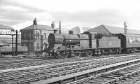 Fowler 0-6-0 no 44399 shunting a sleeping car at the south end of Carlisle station in the summer of 1962.<br><br>[K A Gray&nbsp;04/08/1962]