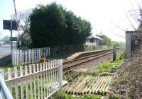 The level crossing at the former Flamborough station (closed 1970) in April 2009. The road on the left runs to the village and on to Flamborough Head, while the line continues south past the abandoned platform and converted station building towards the next open station at Bridlington, just over 2 miles further on. [See image 23785]<br><br>[John Furnevel&nbsp;21/04/2009]