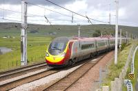 A Southbound Pendolino passes the north end of Abington loop on 30 May.<br> <br><br>[Bill Roberton&nbsp;30/05/2011]