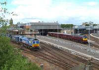 Looking north over Perth station on 30 May 2011. WCR 57001 with <I>'The Royal Scotsman'</i> at platform 3 is by-passed by 66414 <I>'James the Engine'</I> running through platform 7 with a Stobart container train.<br><br>[Brian Forbes&nbsp;30/05/2011]