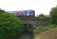 The 12.41 stopping service to Glasgow Central via Shotts leaving Wester Hailes on 31 May 2011. The train is just pulling away from the platform and is about to cross the underpass at the west end of the station.<br><br>[John Furnevel&nbsp;31/05/2011]