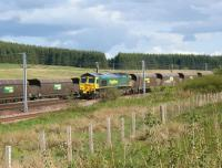 A Freightliner Class 66 brings coal empties north over Beattock <br> Summit on 30 May 2011, while another Freightliner is held in the up loop with a loaded train from  Ravenstruther destined for Drax Power Station.<br><br>[John McIntyre 30/05/2011]