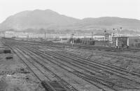 A scene of dereliction at Niddrie West Yard in 1974 with Arthur's Seat dominating the background. Niddrie West signal box still stands over on the right. [See image 32503]<br><br>[Bill Roberton&nbsp;//1974]