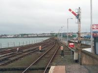 Looking back along the breakwater from the platform end at Harbour station towards Stranraer itself. This picture shows the one line that remains in regular use, the switched out signals and the other rusty (although still usable) track and pointwork. <br><br>[Mark Bartlett&nbsp;25/05/2011]
