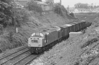 Scene on the 'sub' in 1974 as 40160 coasts downhill towards the site of Newington Station with a mixed freight for Millerhill. In the right background new houses now occupy the former goods yard.<br> <br><br>[Bill Roberton&nbsp;//1974]