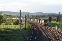 A southbound DRS container train waits in the Eden Valley loop just <br> south of Penrith on the evening of 30 May 2011. This was the point at which the NER line to Appleby and Kirkby Stephen left the WCML and headed east. A short distance away behind the camera is the site of the former Clifton and Lowther station. <br> <br><br>[John McIntyre&nbsp;30/05/2011]