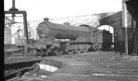 One of the mighty Raven Q7 0-8-0s, no 63472, photographed on the roofless Tyne Dock shed in 1960. These powerful locomotives were eventually displaced from the Tyne Dock - Consett iron ore trains following the arrival of the BR Class 9F 2-10-0s in the late 1950s. Tyne Dock shed was officially closed by BR in September 1967.<br><br>[K A Gray&nbsp;//1960]