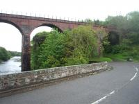 Two bridges in retirement in May 2011. In the foreground is the old A75 road bridge, which since the Glenluce bypass was completed has only carried a farm access road. Beyond, also spanning the River Luce, is the single track railway viaduct that carried <I>The Port Road</I> until closure in 1965.  <br><br>[Mark Bartlett&nbsp;23/05/2011]