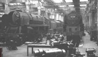 BR Standard class 9F 2-10-0s nos 92211 & 92205 receive attention in the workshops at York in May 1964.<br><br>[K A Gray&nbsp;02/05/1964]