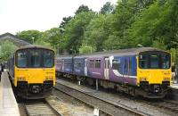 Class 150 DMUs standing at Buxton Station on 4 June 2011.<br><br>[Peter Todd&nbsp;04/06/2011]