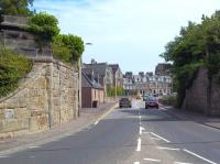 The gateway to St Andrews is the dismantled railway bridge that carried the line over the A91 road at the western edge of the town, seen here in May 2011. Hard to imagine the <I>'Fife Coast Express'</I> [see image 26205] in days gone by, slowing as it crossed the bridge prior to pulling up at its ultimate destination. The former station (closed January 1969), St Andrews second, was located off to the right and is now a car park.<br> <br><br>[Andrew Wilson&nbsp;30/05/2011]