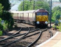 WCRC 47790, sporting its new livery, about to bring the ECS of the <I>Northern Belle</I> over the junction and onto 'wrong line' working at Westerton on 3 June. The original intention was to stable the ECS at Mossend but due to late running it went to Cadder yard instead.<br><br>[Ken Browne&nbsp;03/06/2011]