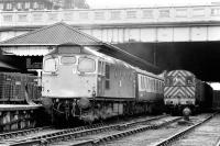 5399 ready to leave Waverley in 1974, with steam escaping from the train heating pipes and 'Brutes' standing on the platform. A 350HP shunter waits alongside.<br><br>[Bill Roberton&nbsp;//1974]