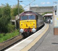 WCRC 47790 bringing up the rear of the 1Z33 <I>Northern Belle</I> tour as it runs through Hyndland station on a sunny 3 June 2011. The locomotive is sporting its new <I>Northern Belle</I> livery. On the front of the train is WCRC no 47810.<br><br>[Ken Browne&nbsp;03/06/2011]